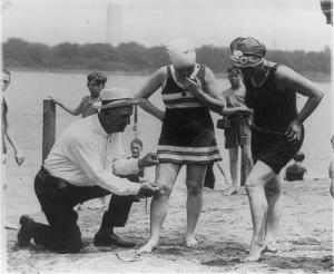 In the 19s0 don't get those bathing suits too short or the man whose job it was to measure to make sure bathing suits were the proper length might make you get back in your street clothes. You could also be cited for indecent exposure.