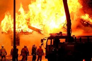 0420-1003-0211-1249_firefighters_battling_blazing_fire_s