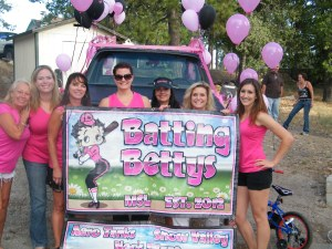 "Members of the Batting Bettys team from the Women's Softball League had a lot of fun in the parade. ""Play Ball,"" ladies, we were glad to have you!"