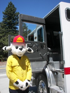 Sparky, the Fire Prevention dog, wants everyone to be careful when using outdoor equipment that could spark a fire.