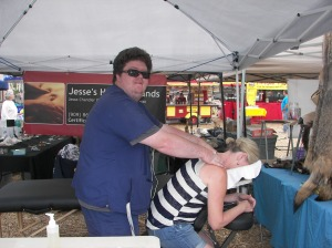 Lifelong mountain resident Jesse Chandler gave free massages at his booth at Jesse''s Helping Hands. People loved getting a free massage adjustment (who wouldn't?)