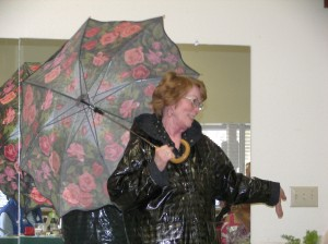 """Love this colorful umbrella and the clothes. Talk about """"Singin' in the Rain....Gene Kelley would have loved it!"""