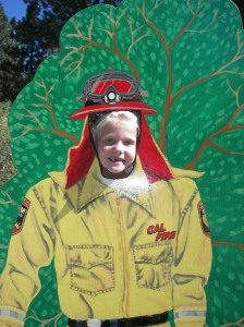 "Kids had way too much fun sticking their head through the hole in this wooden ""firefighter"" cutout. Great fun!"