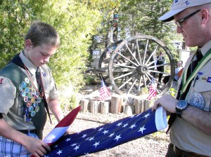 Retiring the old flag with help for the ceremony by  the Boy Scouts.